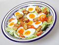 Egg and tomato salad bowl Stock Photography