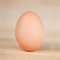 Egg on wooden table closeup of an Royalty Free Stock Image