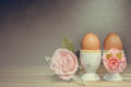 Eggcup and boiled egg on wooden table couple in love feel Royalty Free Stock Photography