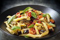 Eggplant chilli and tomato pasta penne on a black serving platter garnished with basil Royalty Free Stock Photo