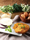 Eggplant cutlet with beaten egg and breadcrumbs on complex background Stock Images