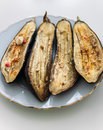 Eggplant on a platter gourmet food of grilled withchees and olive oil Royalty Free Stock Image