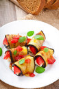 Eggplant rolls stuffed with cheese a slice of tomato Royalty Free Stock Images
