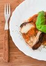 Eggplant rolls with tomato sauce. Stock Photos