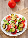 Eggplant salad with tomato and feta cheese Royalty Free Stock Images