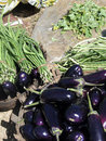 Eggplants andf long green beans for sale in weekly market orissa chatikona orissa india Stock Photo