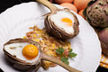 Eggs In Artichokes Stock Images