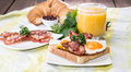 Eggs and bacon croissant orange juice Stock Image