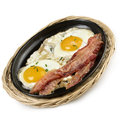 Eggs and bacon fried in a skillet Royalty Free Stock Images