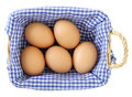 Eggs in basket isolated on white Royalty Free Stock Photos