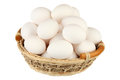 Eggs basket over white background Stock Image