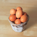 Eggs in a basket wicker on table Royalty Free Stock Images