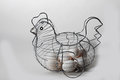 Eggs in a basket wire hen shaped Royalty Free Stock Photo