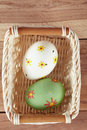 Eggs in basket on wood colored painted the Stock Image