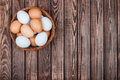 Eggs in basket on a wooden background Stock Images
