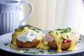 Eggs Benedict- toasted muffins, ham, poached eggs, and delicious buttery hollandaise sauce Royalty Free Stock Photo