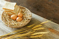 Eggs and breads in the basket Royalty Free Stock Photo
