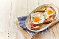 Eggs cooked sunny side up with ham on bread Royalty Free Stock Photo