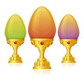 Eggs cup colored easter in a golden goblet on white background Royalty Free Stock Images