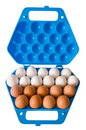Eggs and the dark blue container. Stock Photography