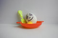 Eggs with face. Concept of nervous tremor Royalty Free Stock Photo