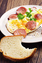 Eggs and fried sausage breakfast with Stock Image