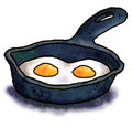 Eggs in a frying pan Royalty Free Stock Photos