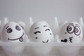 Eggs funny face on the stand Love triangle concept