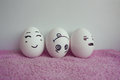 Eggs funny with faces concept of discontent