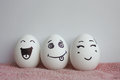 Eggs are funny with faces. Concept of laughter
