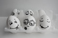 Eggs are funny with faces. Show the language