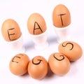 Eggs with an inscription EAT EGGS Royalty Free Stock Photos
