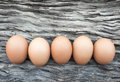 Eggs laid on wooden floor in nature light Royalty Free Stock Photo