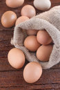 Eggs in a linen sack on the wooden table Royalty Free Stock Photos