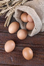 Eggs in a linen sack on the wooden table Stock Images