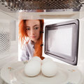 Eggs in microwave Royalty Free Stock Image