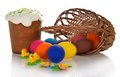 Eggs near basket and easter cake with sweet a an the jewelry isolated on the white Stock Photos