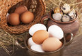 Eggs on old wooden background Stock Photo