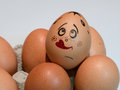 Eggs with painted faces. Photo for your design. Concept of joint