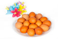 Eggs on the plate with colored paper flowers easter Royalty Free Stock Photos