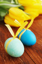 Eggs with ribbon passover holiday still life flowers and Stock Photos