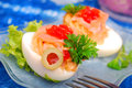 Eggs with smoked salmon and red caviar Royalty Free Stock Photo