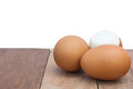 Eggs still life laid on the old wooden floor and white background peeled laid back Royalty Free Stock Image