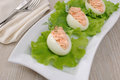 Eggs stuffed with salmon pate in lettuce leaves Royalty Free Stock Images