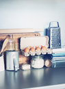 Eggs table ware grocery different stuff on kitchen table top toned image vertical Royalty Free Stock Photo