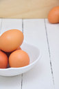 Eggs on white dish and wooden floor Stock Images