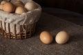 Eggs in a wicker basket on a wooden table