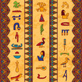 Egypt colorful ornament with ancient Egyptian hieroglyphs and floral geometric ornament border on aged paper background. Royalty Free Stock Photo