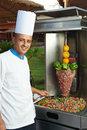 Egyptian arab chef cook uniform making kebab meat vegetables Stock Image