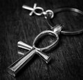 Egyptian cross ankh on a dark background photo toned Royalty Free Stock Photo